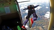 A skydiver jumps out of a plane